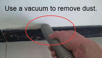 Use a vacuum to remove dust